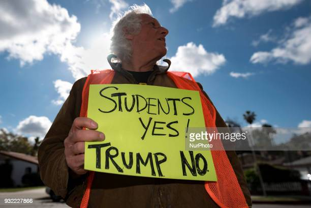 Chuck Levin holds a sign in font of John Marshall High School during a protest against gun violence in Los Angeles California on March 14 2018...