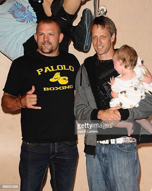 Chuck Liddell Tony Hawk and Kadence Clover Hawk attend Tony Hawk's wax figure unveiling ceremony at Madame Tussauds on July 29 2009 in Hollywood...