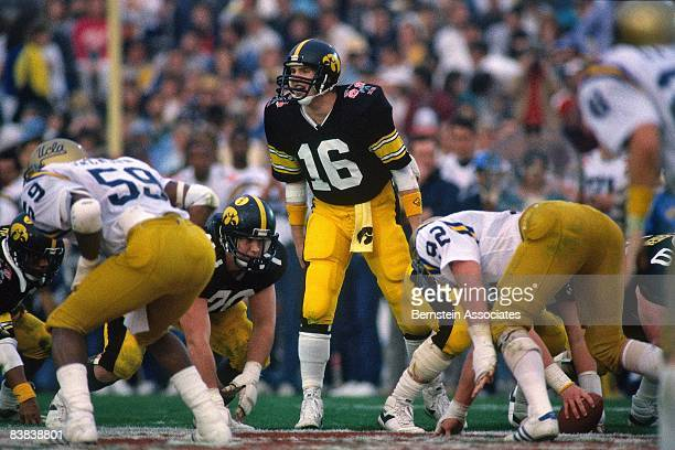 Chuck Long of the Iowa Hawkeyes call a play against the UCLA Bruins during the football game in January 1987 at the Rose Bowl, Pasadena, California.