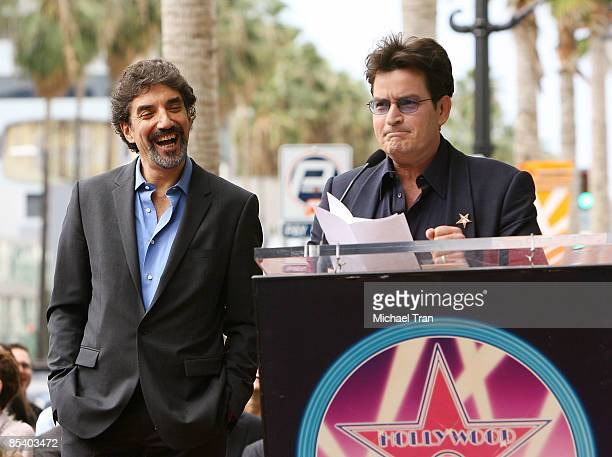 Chuck Lorre and Charlie Sheen attend the ceremony honoring Television Producer Chuck Lorre with a star on the Hollywood Walk of Fame on March 12 2009...