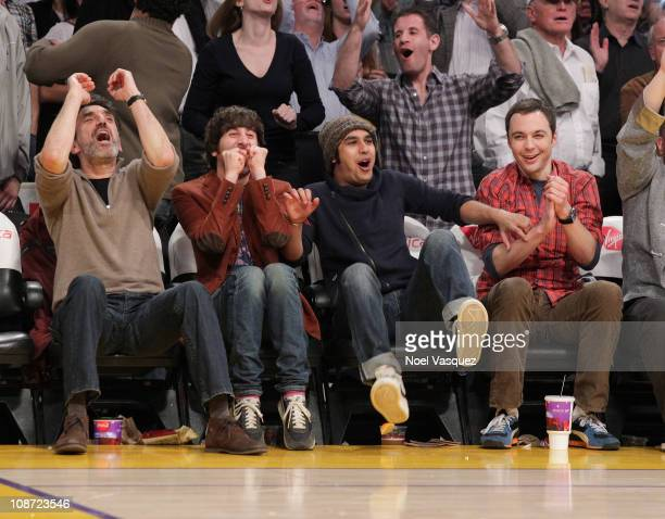 Chuck Lorre Simon Helberg Kunal Nayyar and Jim Parsons attend a game between the Houston Rockets and the Los Angeles Lakers at Staples Center on...
