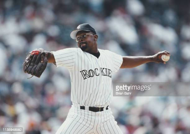 Chuck McElroy pitches for the Colorado Rockies against the Arizona Diamondbacks during their Major League Baseball National League West game on 23...
