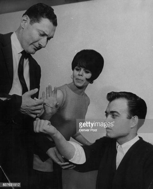 Chuck Muller left prepares to give Norman Jones a shot of truth serum as Jolene Terry tries to stop him in this scene from Catch Me If You Can The...