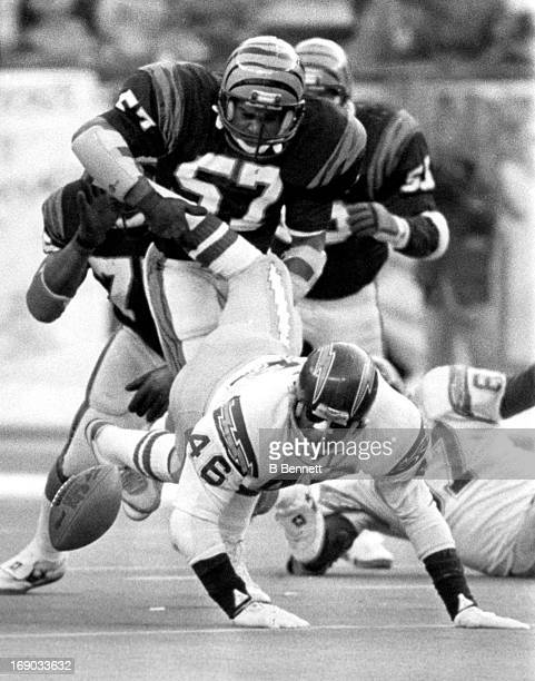Chuck Muncie of the San Diego Chargers fumbles the ball after being hit by Reggie Williams of the Cincinnati Bengals during the 1982 AFC Championship...