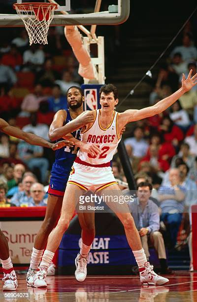 Chuck Nevitt of the Houston Rockets posts up against the New Jersey Nets during an NBA game at the Summit circa 1988 in Houston Texas NOTE TO USER...