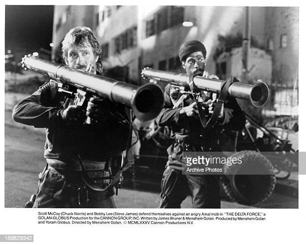 Chuck Norris and Steve James defend themselves against an angry Amal mob in a scene from the film 'The Delta Force' 1986