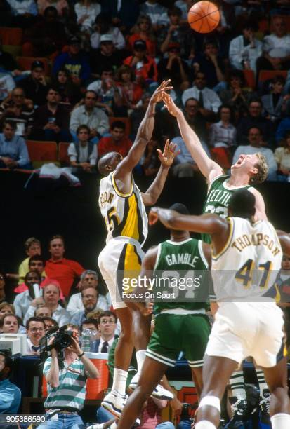 Chuck Person of the Indiana Pacers shoots over Larry Bird of the Boston Celtics during an NBA basketball game circa 1991 at Market Square Arena in...