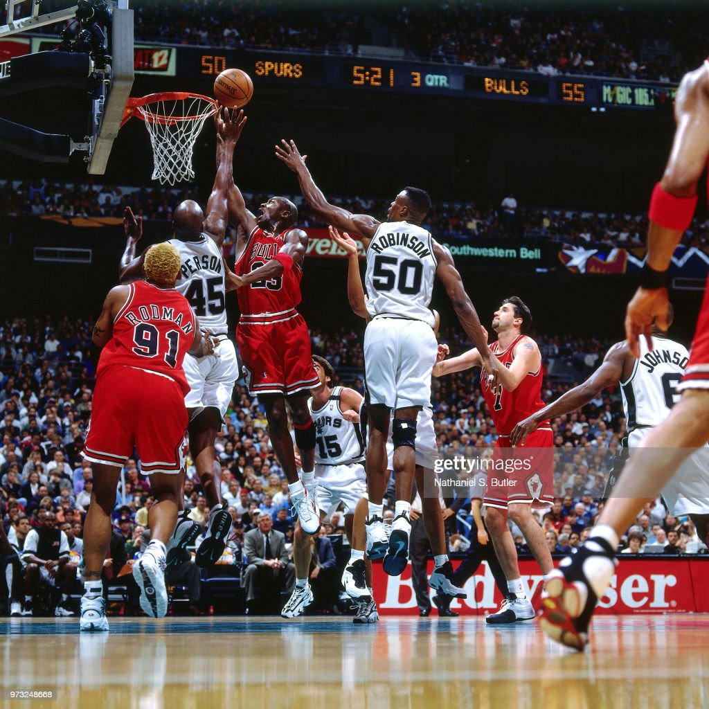 1cb46ab7962ca1 Chuck Person of the San Antonio Spurs defends Michael Jordan of the ...