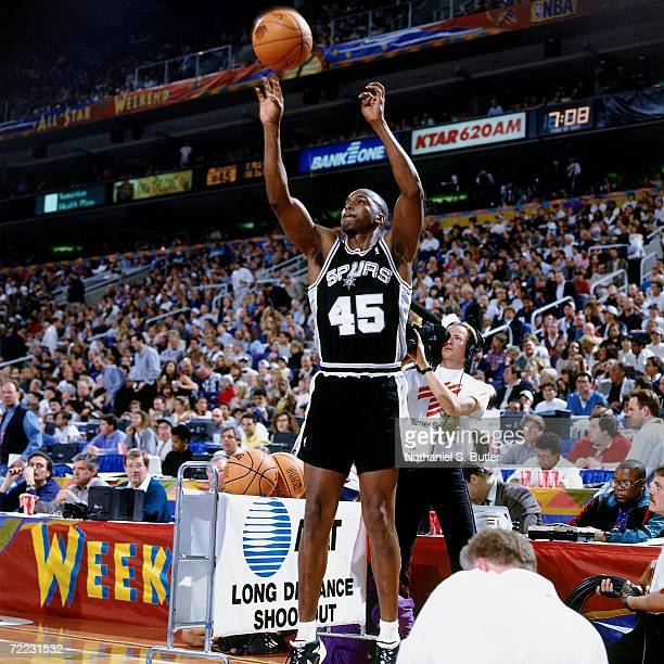 Chuck Person of the San Antonio Spurs shoots during the 1995 ATT Three Point Shootout on February 11 1995 at the America West Arena in Phoenix...
