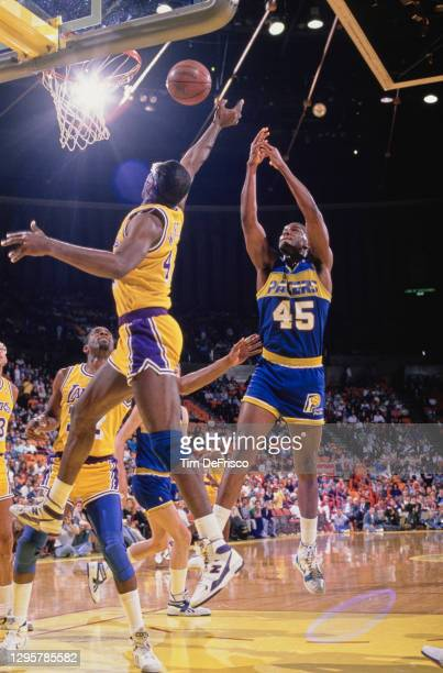Chuck Person, Power Forward for the Indiana Pacers makes a jump shot to the basket as James Worthy of the Los Angeles attempts to block during their...