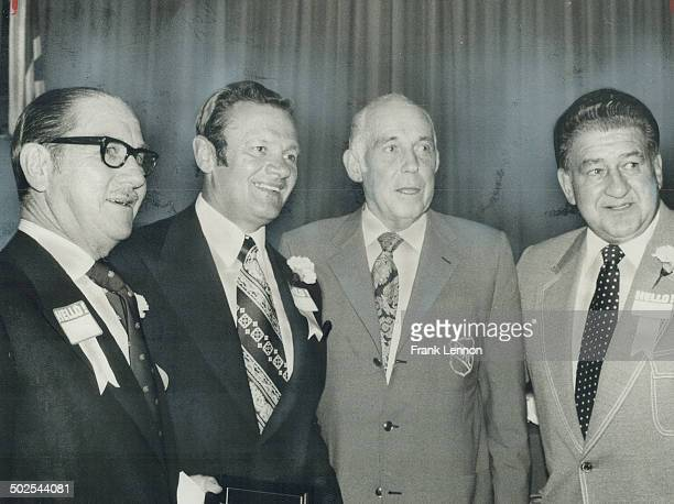 Chuck rayner former New York Ranger goalie joins new members of Hockey Hall of Fame Senator Hartland Molson and Frank Udvari in posing with NHL...