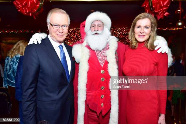 Chuck Scarborough Santa Claus and Ellen Ward Scarborough attend A Christmas Cheer Holiday Party 2017 Hosted by George Farias and Anne and Jay...