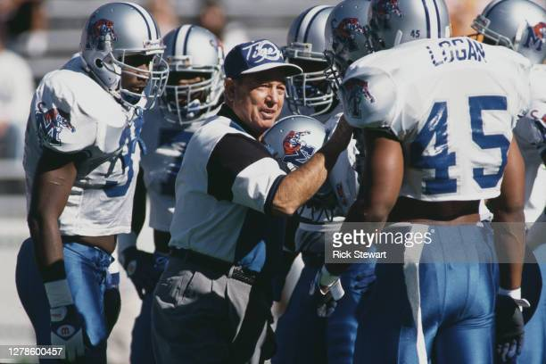 Chuck Stobart, Head Coach for the Memphis State Tigers instructs his team during the NCAA Independent Year college football game against the...