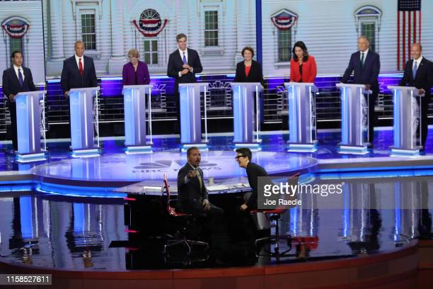 Chuck Todd of NBC News and Rachel Maddow of MSNBC and candidates react to technical difficulties during the first night of the Democratic...