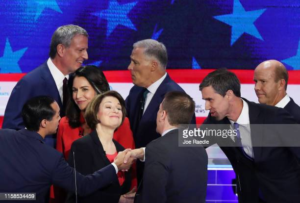 Chuck Todd of NBC News greets Sen Amy Klobuchar former housing secretary Julian Castro former Texas congressman Beto O'Rourke and other candidates...