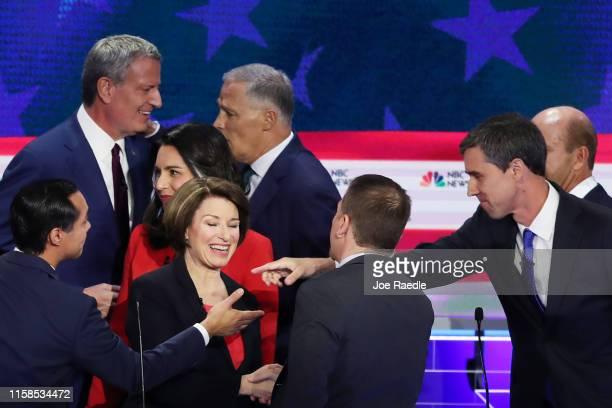 Chuck Todd of NBC News greets Sen Amy Klobuchar former housing secretary Julian Castro former Texas congressman Beto O'Rourke and other candidates...