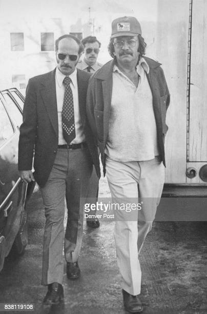 DEC 10 1976 DEC 13 1976 ***** Chuck Waldren being escorted by Littleton Detective Roy Taylor left was one of six men accused by a grand jury of...