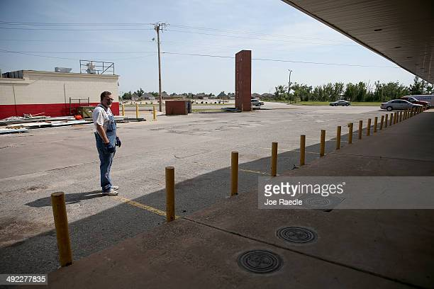 Chuck Walker is seen near his business that was damaged a year ago during the massive tornado on May 18 2014 in Moore Oklahoma On May 20 2013 a...
