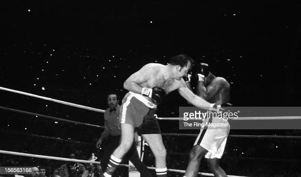 Chuck Wepner throws a punch to Muhammad Ali during a fight at Richfield Coliseum on March 24, 1975 in Richfield, Ohio. Muhammad Ali won both the WBC...