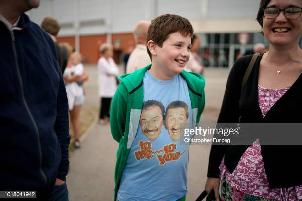 Chuckle Brother fan Alfie Whatmore aged 10 raises a smile as pay his respects to Barry Chuckle before his funeral service at The New York Stadium on...