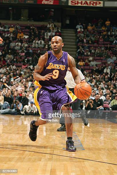 Chucky Atkins of the Los Angeles Lakers moves the ball against the New Jersey Nets on February 9, 2005 at the Continental Airlines Arena in East...
