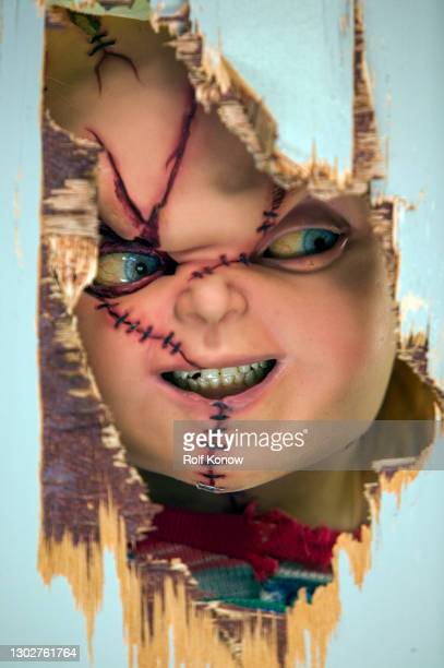 """Chucky imitates Jack Nicholson from """"The Shining"""" in """"Seed of Chucky"""" directed by Don Mancini, 2003"""