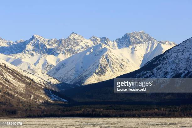 chugach mountains from across the turnagain arm in winter, alaska - chugach state park stock pictures, royalty-free photos & images