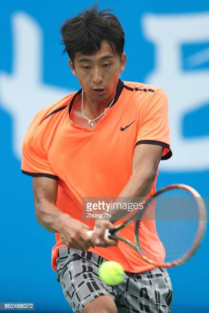 Chuhan Wang of China returns a shot during the match against Jose Statham of New Zealand during Qualifying first round of 2017 ATP Chengdu Open at...