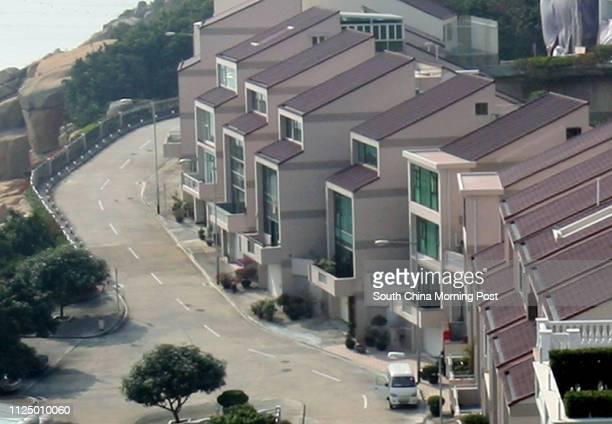 "Chuk Wan Hou Yuen near Hac Sa Beach at Macau. The street name where the properties are located in Macau reads ""Rua Um Dos Jardins De Cheoc Van"". 02..."