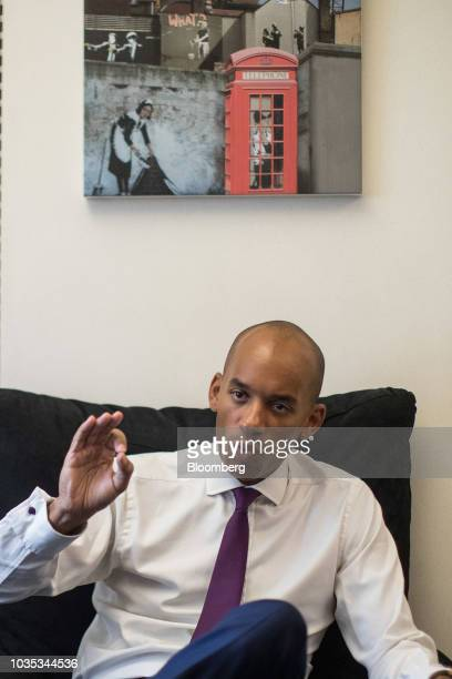 Chuka Umunna UK lawmaker for the opposition Labour party poses for a photograph following an interview at his offices at the Houses of Parliament in...