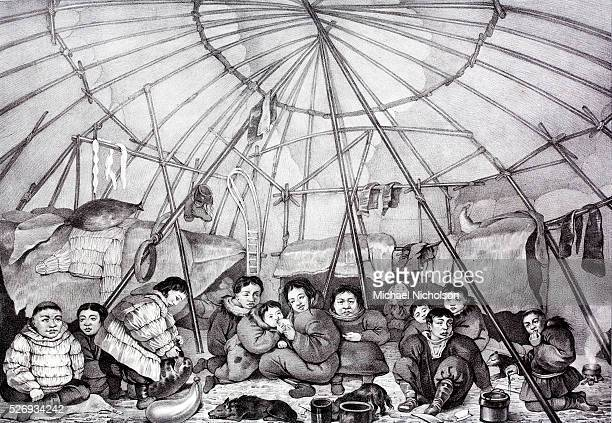 Chukchi or Chukchee in a well appointed skin covered tent In the background are snowshoes hides leather bottles The Chukchi are the indigenous people...