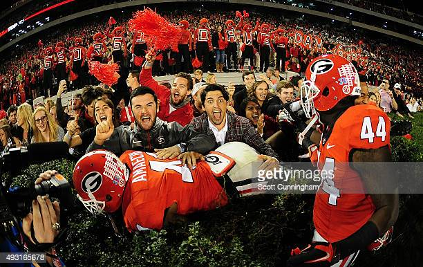 Chuks Amaechi of the Georgia Bulldogs celebrates with fans after the game against the Missouri Tigers on October 17, 2015 in Atlanta, Georgia. Photo...