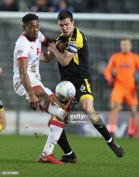 Chuks Aneke of Milton Keynes Dons contests the ball with Richard Wood of Rotherham United during the Sky Bet League One match between Milton Keynes...