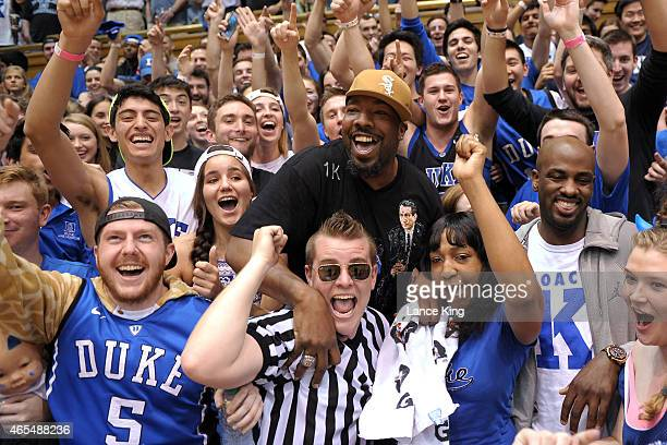Chukwudi Okafor father of Jahlil Okafor of the Duke Blue Devils cheers with the Cameron Crazies during a game against the Wake Forest Demon Deacons...