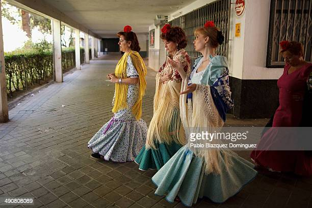 'Chulapas' from the 'Association of Rompe y Rasga' make their way to Pradera de San Isidro park during the San Isidro festivities on May 15 2014 in...