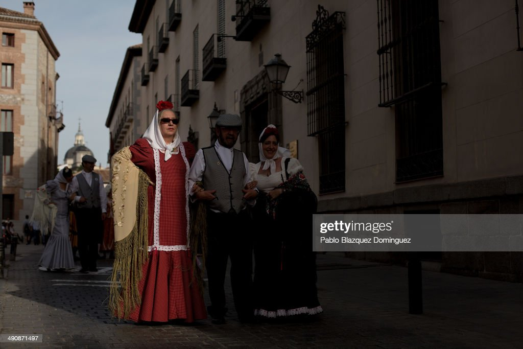 Chulapas take part in the San Isidro procession during the San Isidro festivities on May 15, 2014 in Madrid, Spain. During the festivities in honor of San Isidro Labrador in Madrid revelers take the streets and enjoy music and popular food. Chulapos or Goyescos dance the regional dance known as 'chotis' wearing traditional costumes of Madrid.