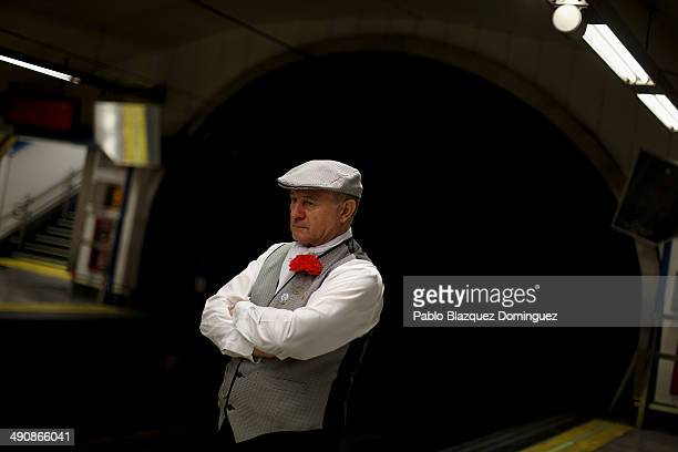 A 'chulapo' waits for a train on his way to Pradera de San Isidro park during the San Isidro festivities on May 15 2014 in Madrid Spain During the...