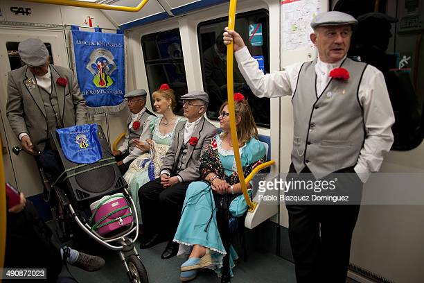 'Chulapos' and 'chulapas' travel in a train during the San Isidro festivities on their way to Pradera de San Isidro park on May 15 2014 in Madrid...