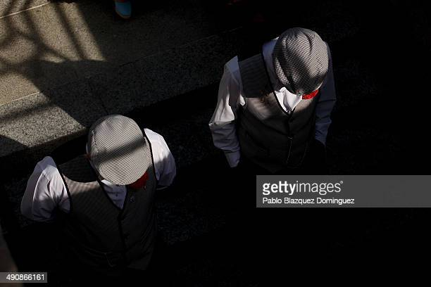 'Chulapos' of the 'Association of Rompe y Rasga' enter the underground during the San Isidro festivities as they make their way to Pradera de San...