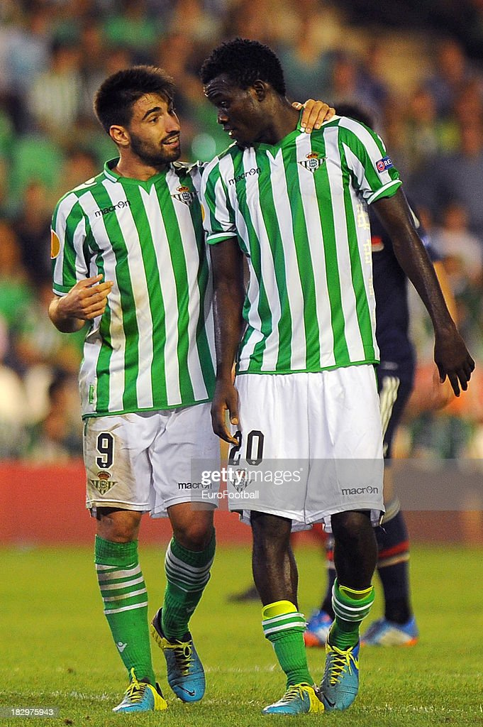 Chuli (L) and Nosa of Real Betis Balompie in action during the UEFA Europa League group stage match between Real Betis Balompie and Olympique Lyonnais held on September 19, 2013 at the Benito Villamarin Stadium, in Seville, Spain.