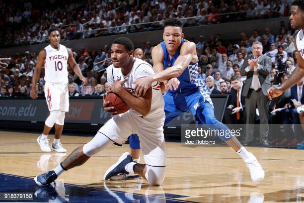 Chuma Okeke of the Auburn Tigers battles for a rebound against Kevin Knox of the Kentucky Wildcats in the first half of a game at Auburn Arena on...