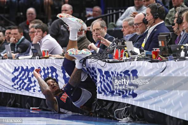 Chuma Okeke of the Auburn Tigers crashes into the scorers table during their game against the Kansas Jayhawks in the Second Round of the NCAA...