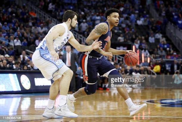Chuma Okeke of the Auburn Tigers dribbles against Luke Maye of the North Carolina Tar Heels during the 2019 NCAA Basketball Tournament Midwest...