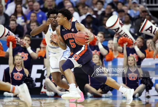 Chuma Okeke of the Auburn Tigers dribbles against the North Carolina Tar Heels during the 2019 NCAA Basketball Tournament Midwest Regional at Sprint...