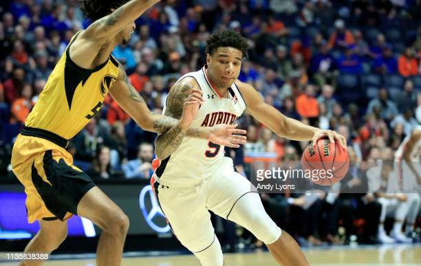 Chuma Okeke of the Auburn Tigers dribbles the ball against the Missouri Tigers during the second round of the SEC Basketball Tournament at...