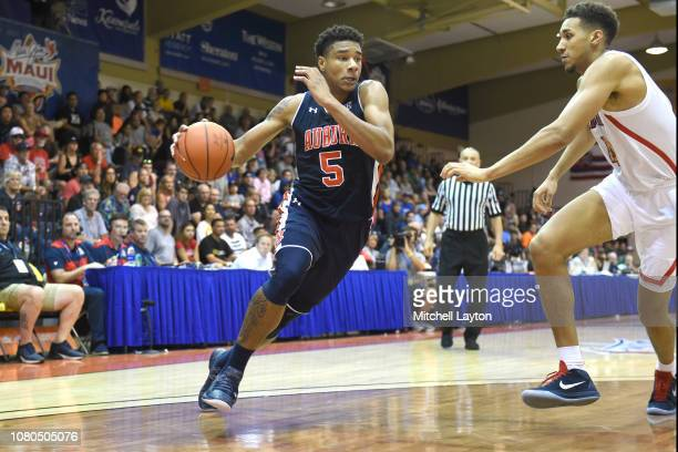 Chuma Okeke of the Auburn Tigers dribbles the ball during a consolation game of the Maui Invitational college basketball game against the Arizona...