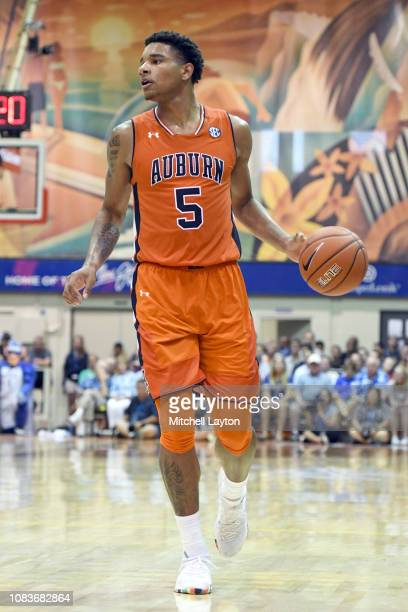 Chuma Okeke of the Auburn Tigers dribbles the ball during a second round game of Maui Invitational college basketball game against the Duke Blue...