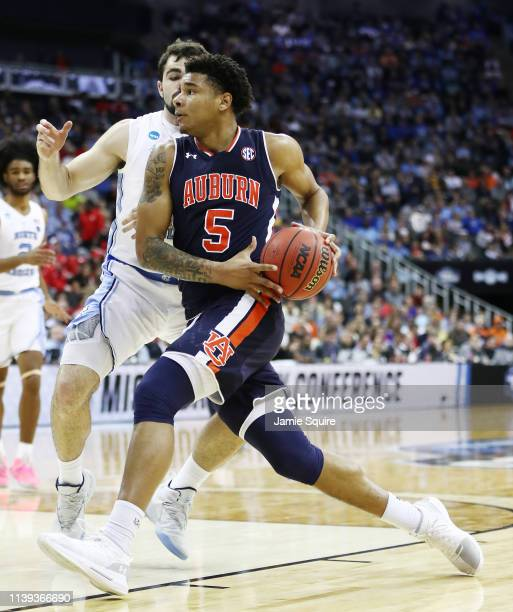 Chuma Okeke of the Auburn Tigers drives to the basket against Luke Maye of the North Carolina Tar Heels during the 2019 NCAA Basketball Tournament...