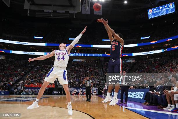 Chuma Okeke of the Auburn Tigers goes up for a shot against Mitch Lightfoot of the Kansas Jayhawks during their game in the Second Round of the NCAA...