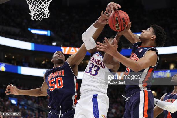 Chuma Okeke of the Auburn Tigers grabs a rebound from David McCormack of the Kansas Jayhawks during their game in the Second Round of the NCAA...